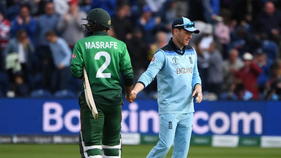 Bangladesh's captain Mashrafe Mortaza (L) shakes hands with England's captain Eoin Morgan after the 2019 Cricket World Cup group stage match between England and Bangladesh at Sophia Gardens stadium in Cardiff, south Wales, on June 8, 2019, as England beat Bangladesh by 106 runs. (AFP)