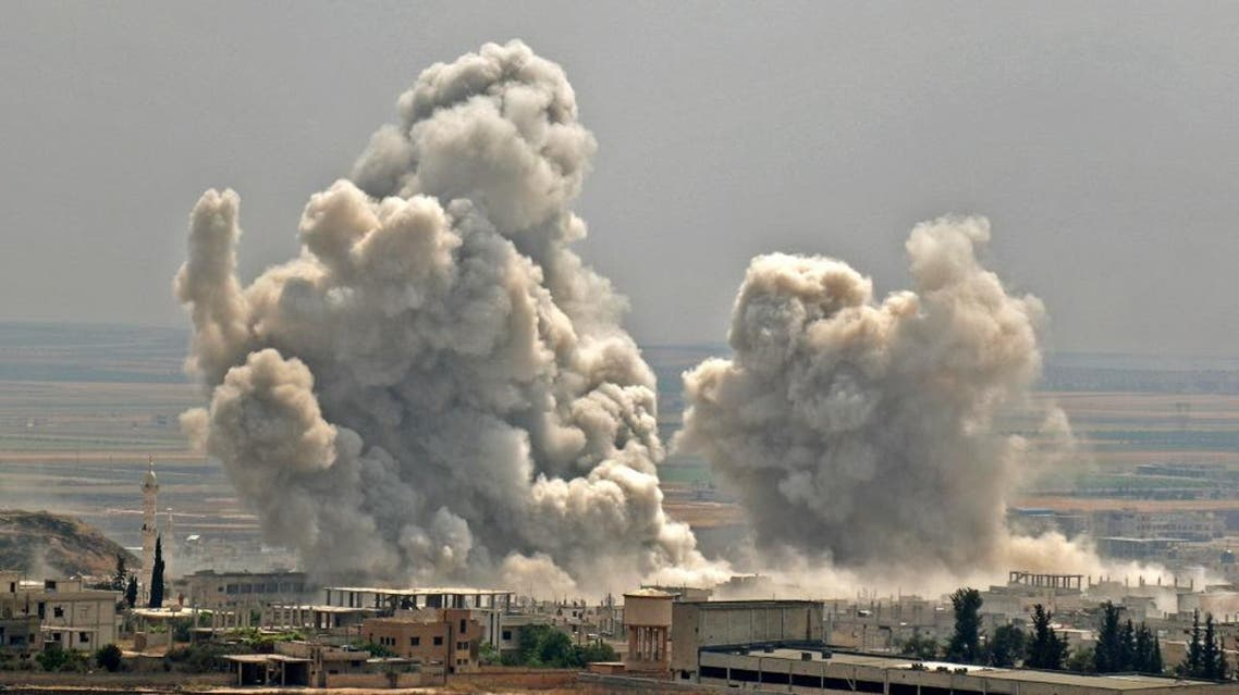 Plumes of smoke rise following reported Syrian government forces' bombardment on the town of Khan Sheikhun, countryside of Idlib. (AFP)