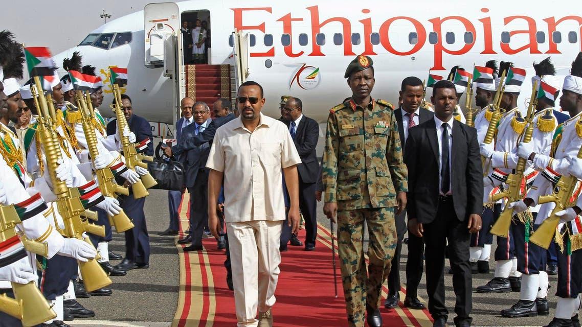Ethiopia's Prime Minister Abiy Ahmed (C-L) walks alongside Shams-Eddin Kabashi Sudan's Transitional Military Council (TMC) spokesman (C-R) upon his arrival at Khartoum international airport on June 7, 2019 AFP