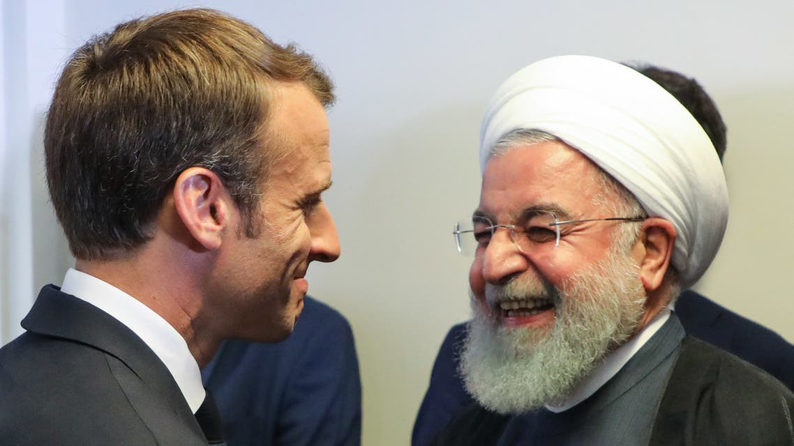 French President Emmanuel Macron (L) meets with Iranian President Hassan Rouhani (R) on the sidelines of the UN General Assembly at the UN headquarters on September 25, 2018, in New York.