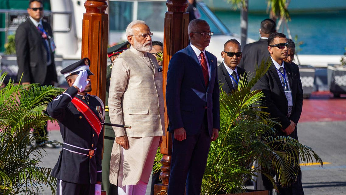 Indian Prime Minister Narendra Modi (L) stands next to Maldives' President Ibrahim Mohamed Solih during a welcome ceremony at Republic square in Maldive's capital Male on June 8, 2019.