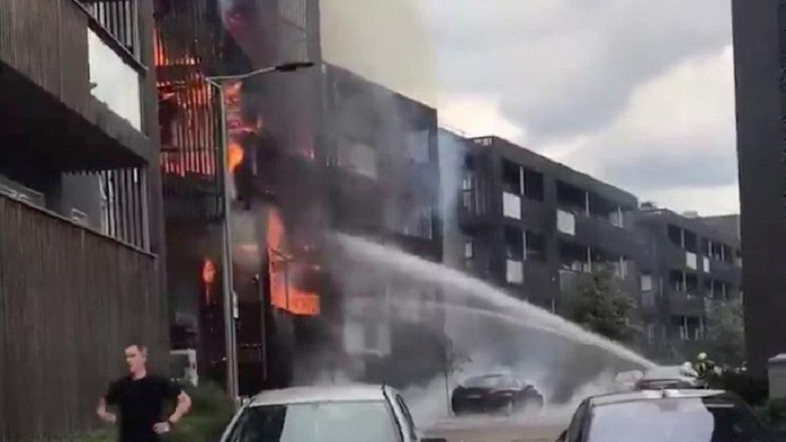 A still image taken from a video obtained on social media shows a fire in a block of flats in Barking, East London, Britain, on June 9, 2019. (Amara Waseem/via Reuters).