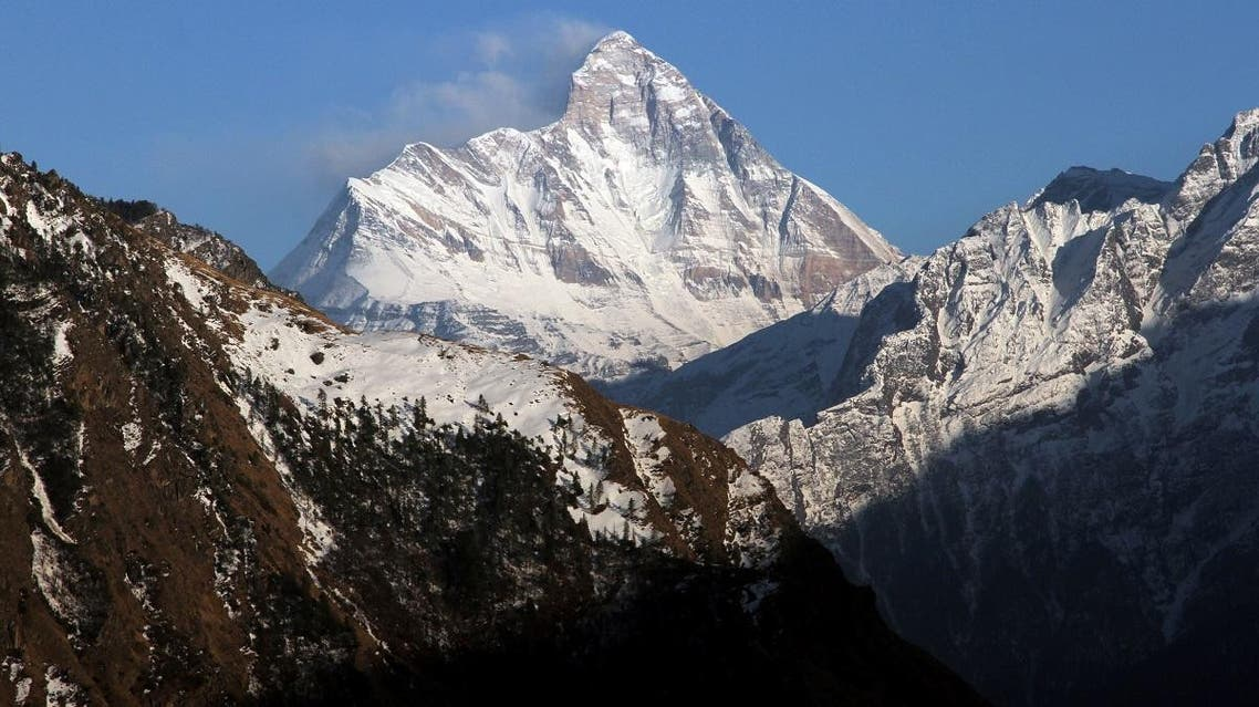 now-covered Nanda Devi mountain is seen from Auli town, in the northern Himalayan state of Uttarakhand, India February 25, 2014. REUTERS/