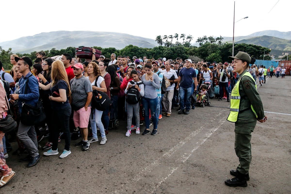 Venezuelans crossing into Colombia after partial reopening of border. (AFP)