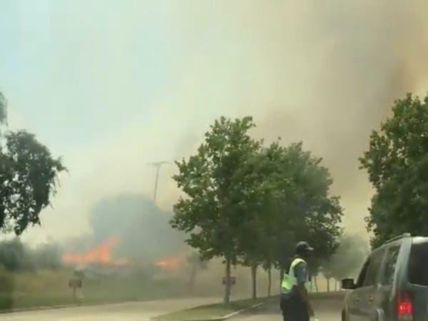 الحرائق تستعر في كاليفورنيا.. وإخلاء متنزه ترفيهي شهير