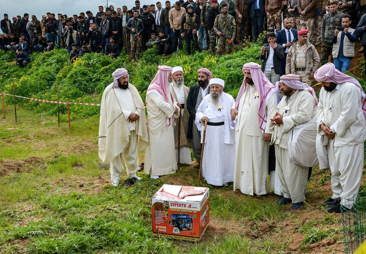 Iraqi Yazidi clerics attend the exhumation of a mass-grave of hundreds of Yazidis killed by Islamic State (IS) group militants in the northern Iraqi village of Kojo in Sinjar district on March 15, 2019. (AFP)