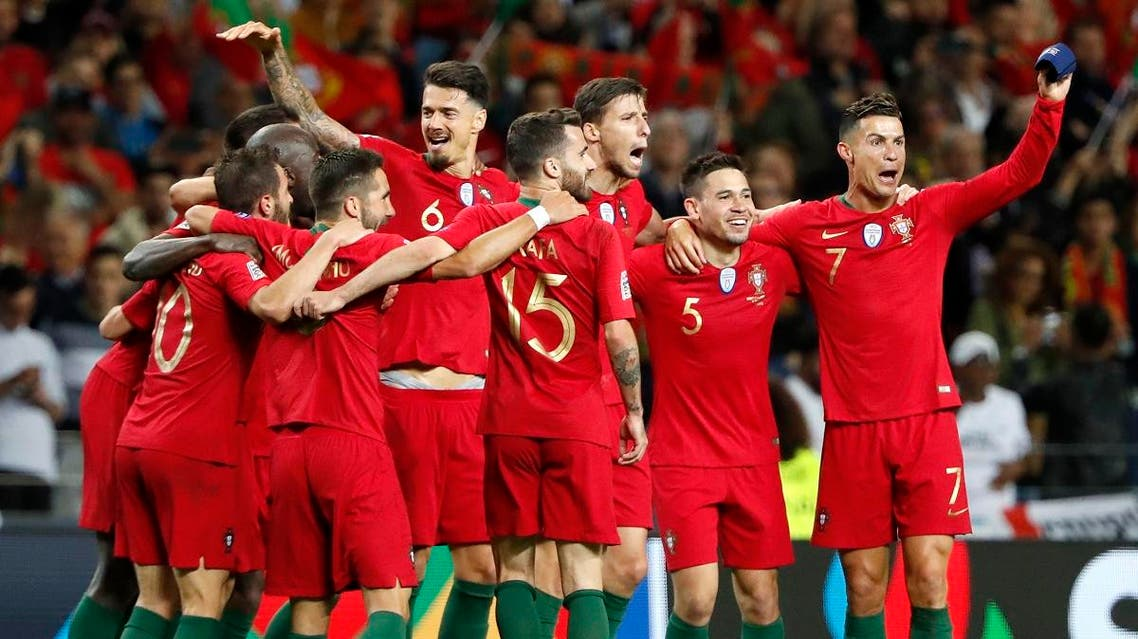 Portugal players celebrate after defeating the Netherlands 1-0 in the UEFA Nations League final soccer match at the Dragao stadium in Porto, Portugal, Sunday, June 9, 2019. (AP)