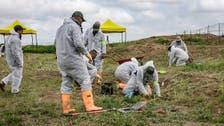 Iraq begins examining Yazidi mass graves remains