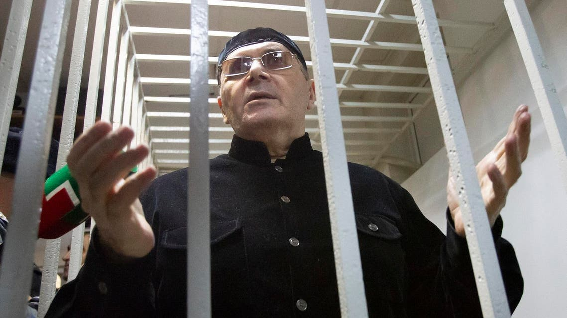 Oyub Titiev behind bars in a court after a hearing in Shali, Russia, on March 18, 2019. (AP)