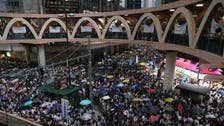 Hong Kong protesters take aim at Chinese visitors to explain grievances