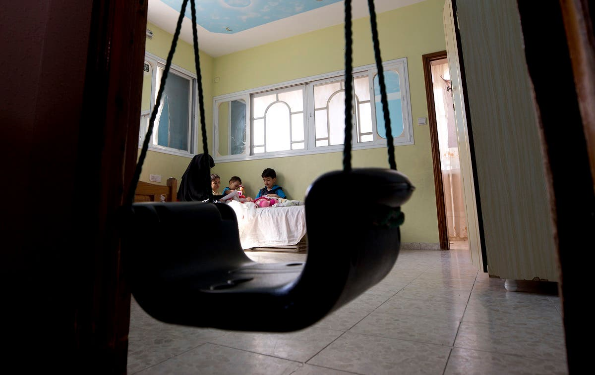 Muna Awad, mother of 5-year-old Aisha a-Lulu, sits with her children in Aisha's room at the family house in Burij refugee camp in central Gaza Strip. (AP)