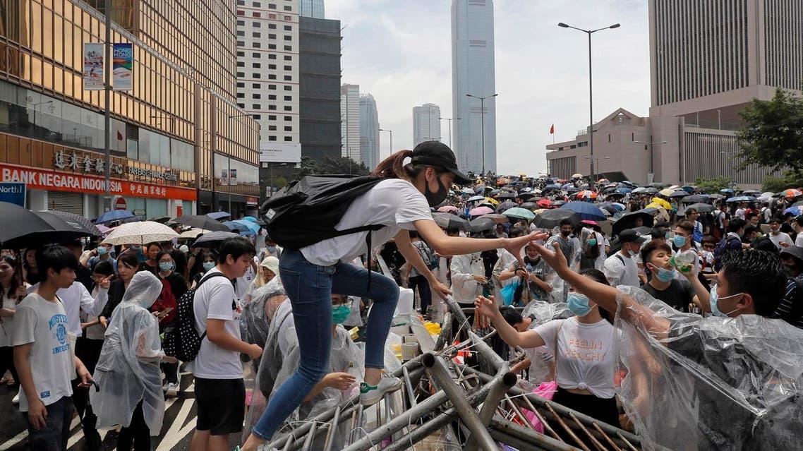 Protestors gather near the Legislative Council in Hong Kong, Wednesday, June 12, 2019. (AP) (correct)