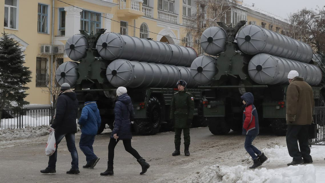 FILE PHOTO: People walk past Russian S-400 missile air defence systems before the military parade to commemorate the 75th anniversary of the battle of Stalingrad in World War Two, in the city of Volgograd, Russia February 2, 2018. REUTERS/Tatyana Maleyeva/File Photo
