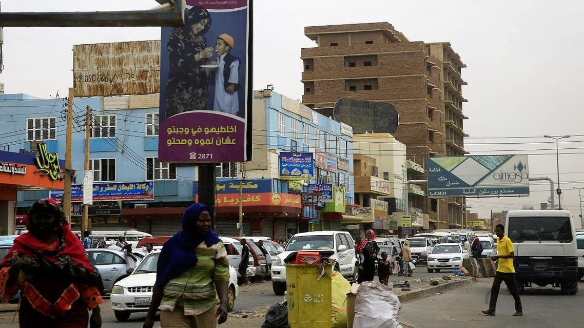 A general view shows Sudanese people and traffic along a street in Khartoum, Sudan, on June 11, 2019. (Reuters)