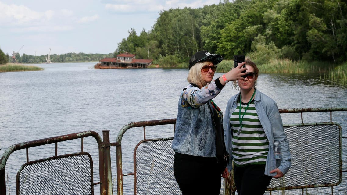Visitors take a selfie at a river port of Pripyat, near the Chernobyl nuclear power plant, on June 2, 2019. (Reuters)