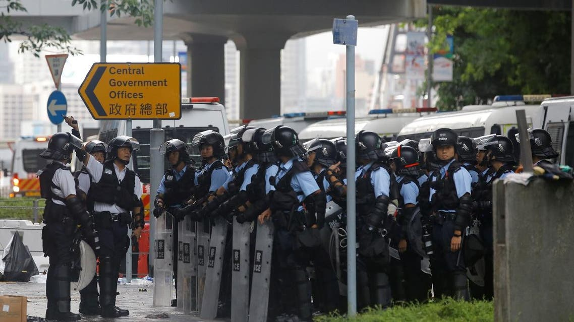 Riot police gather outside the Legislative Council, following a day of violence over an extradition bill that would allow people to be sent to mainland China for trial, in Hong Kong, China June 13, 2019. (Reuters)