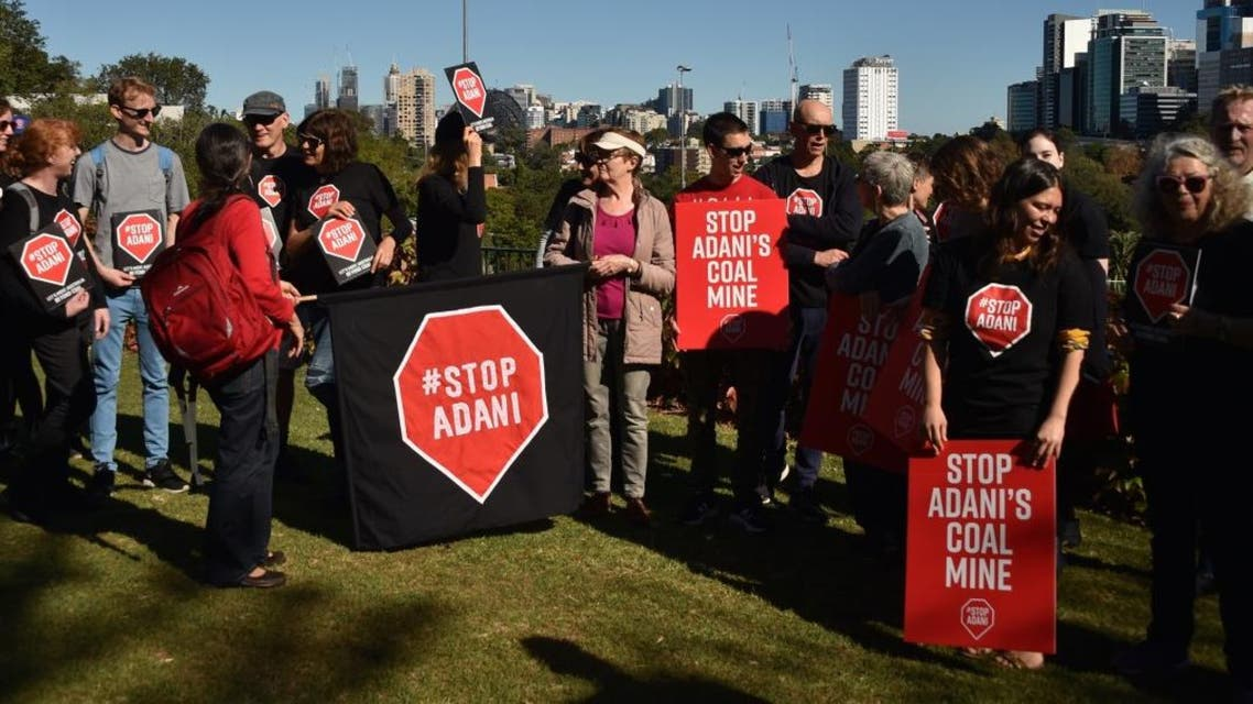Anti-Adani coal mine protesters preparing to door knock residents to vote out climate change as it would threaten vulnerable species. (AFP)