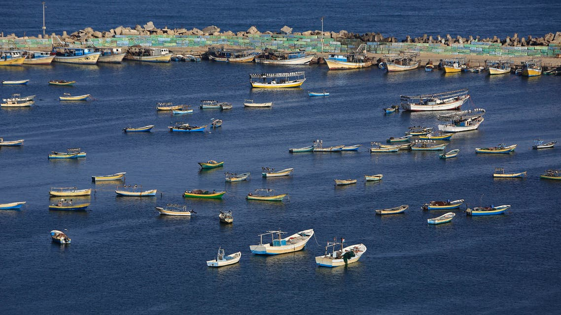 Palestinian fishermen's boats are pictures in the Mediterranean sea at the port in Gaza City on May 10, 2019 a week after a deadly two-day escalation in violence between the Hamas-ruled Gaza Strip and Israel. Israel announced it is loosening restrictions on fishermen off the blockaded Gaza Strip by allowing them to travel up to 12 nautical miles into the Mediterranean one week after a ceasefire.