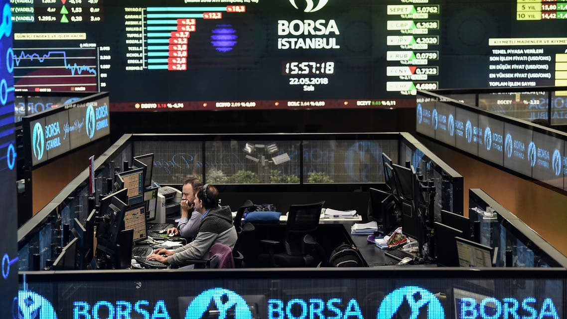 Traders work at their desks on the floor of the Borsa Istanbul in Istanbul on May 22, 2018.