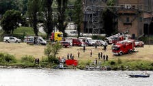 Stunt pilot killed after his plane plunges into Polish river