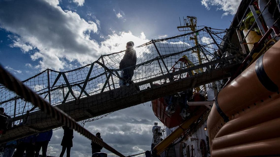 A migrant disembarks from the Dutch-flagged Sea Watch 3 NGO rescue vessel after it docked on January 31, 2019 in the Sicilian port of Catania, southeastern Sicily. (AFP)