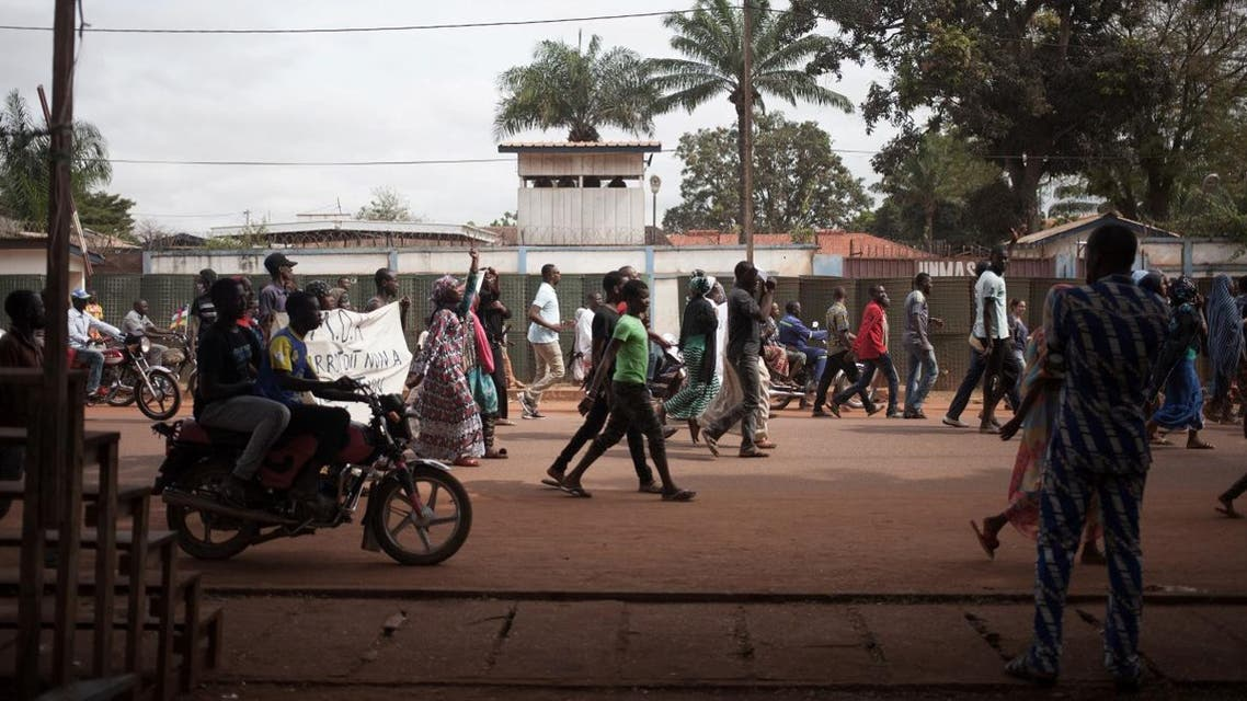 File photo of Protesters walking in front of a peacekeeping mission during a demonstration against the dismissal of the speaker of the National Assembly, Abdou Karim Meckassoua, on October 23, 2018 in Bangui. (AFP)