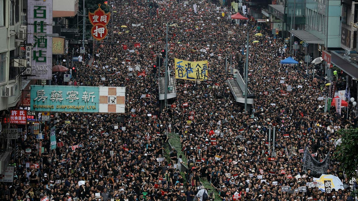 Tens of thousands of protesters march through the streets as they continue to protest an extradition bill in Hong Kong on June 16, 2019. (AP)