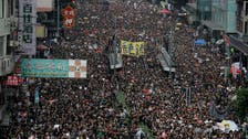 Huge crowds march in Hong Kong, piling pressure on leader