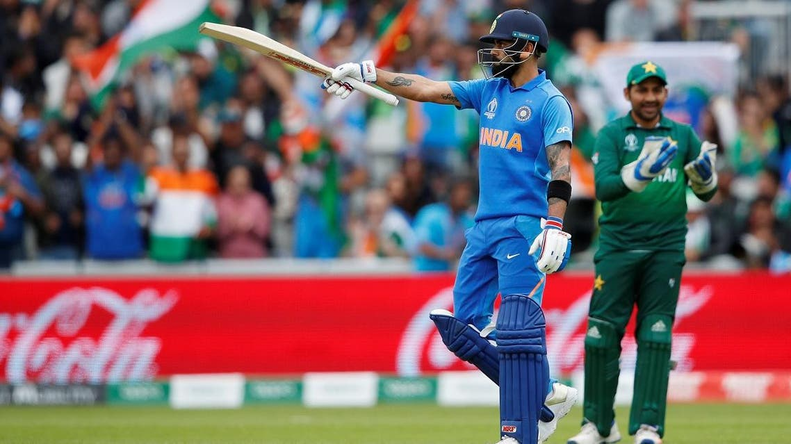 India's Virat Kohli celebrates his 50 during the 2019 Cricket World Cup group stage match against India at Old Trafford in Manchester, northwest England, on June 16, 2019. (Reuters)