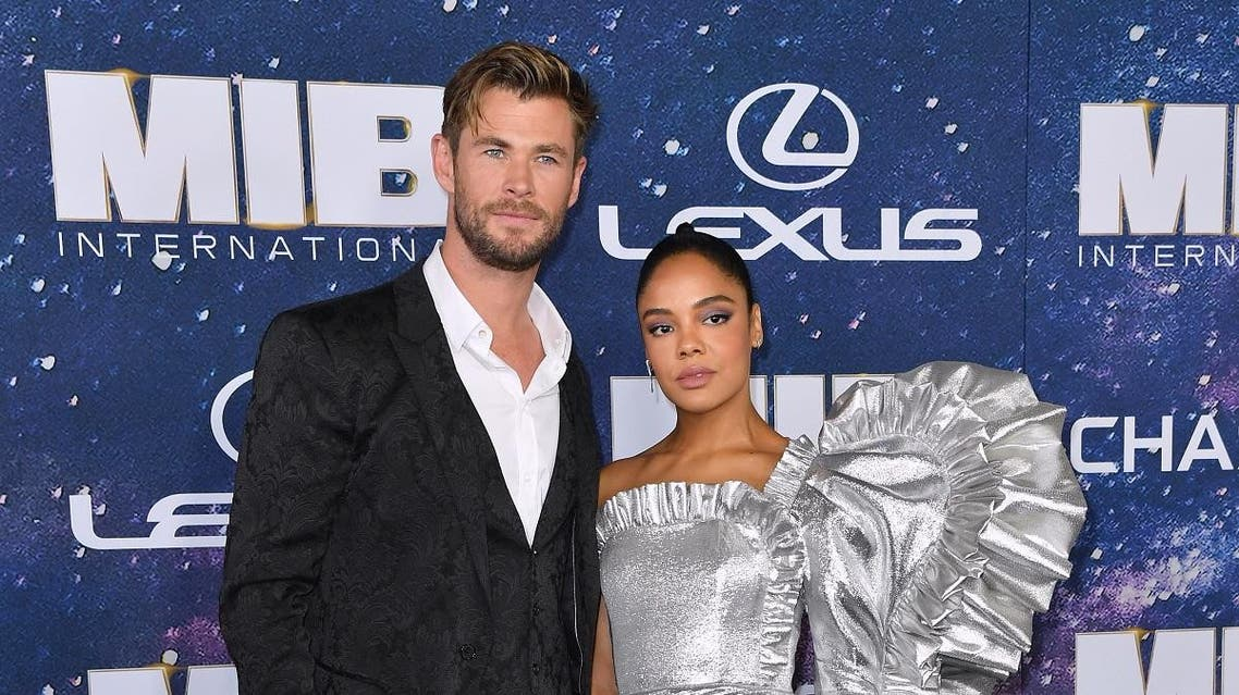"""Australian actor Chris Hemsworth and US actress Tessa Thompson attend the """"Men In Black: International"""" premiere at AMC Lincoln Square on June 11, 2019 in New York City. (AFP)"""
