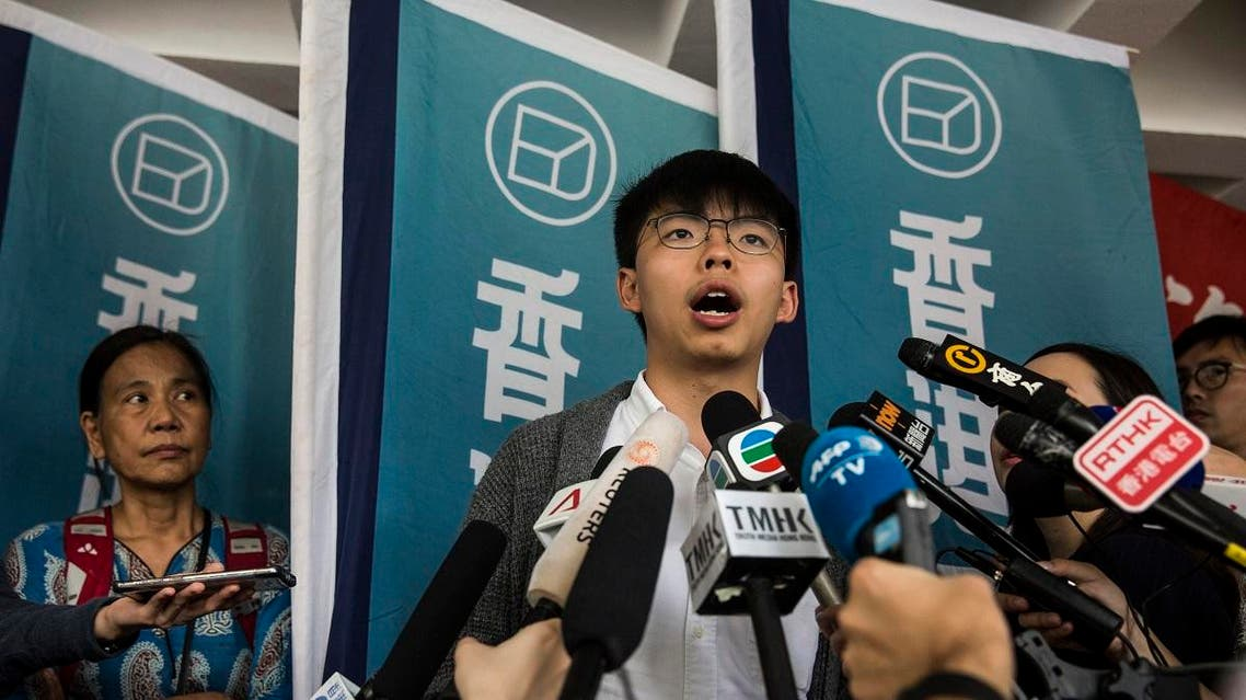 Pro-democracy activist Joshua Wong speaks to the media in front of the high court in Hong Kong on May 16, 2019, before judgement is handed down on his appeal of a three-month jail term received for contempt of court during the clearance of Mong Kok at the 2014 occupy protests. (AFP)