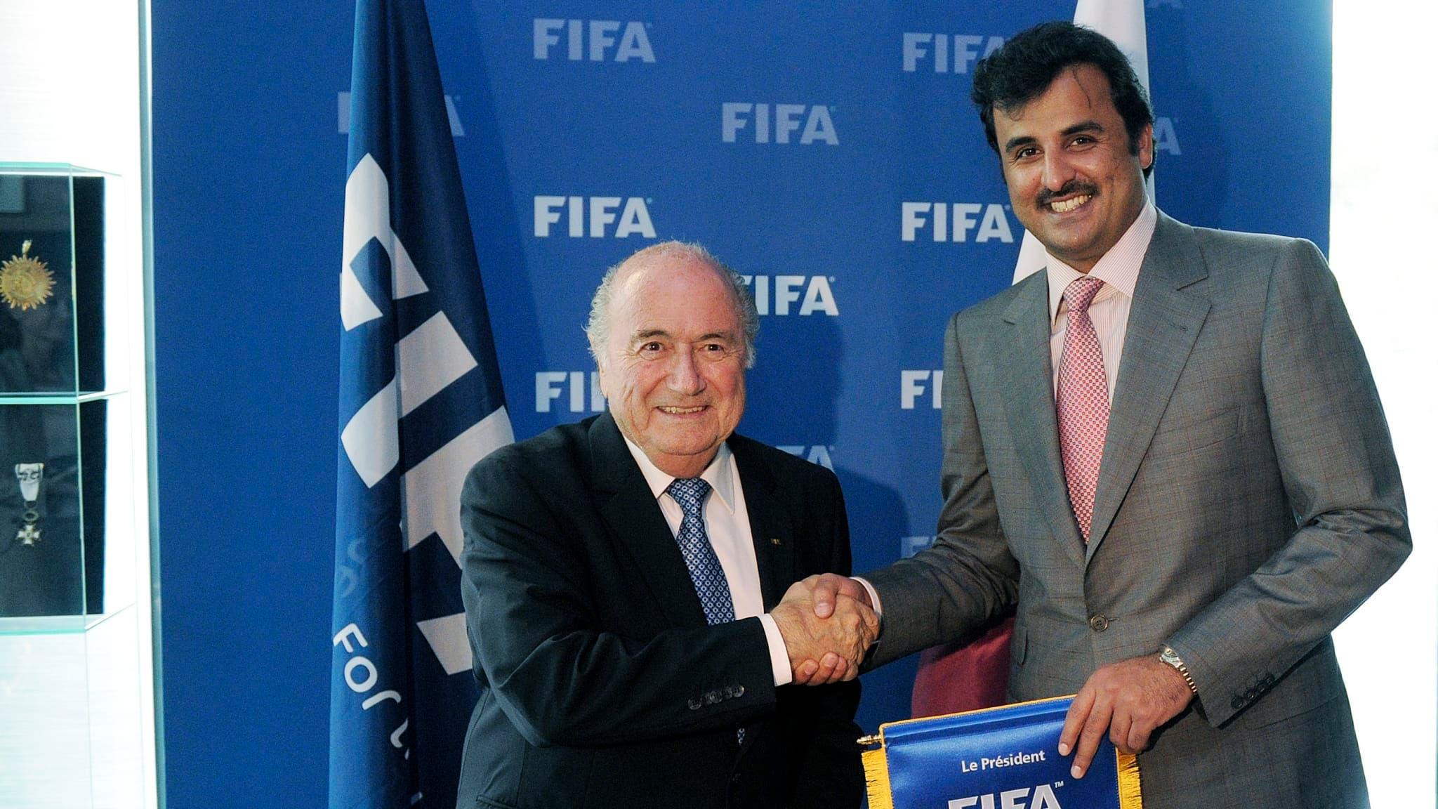 أمير قطر مع الرئيس السابق للاتحاد الدولي