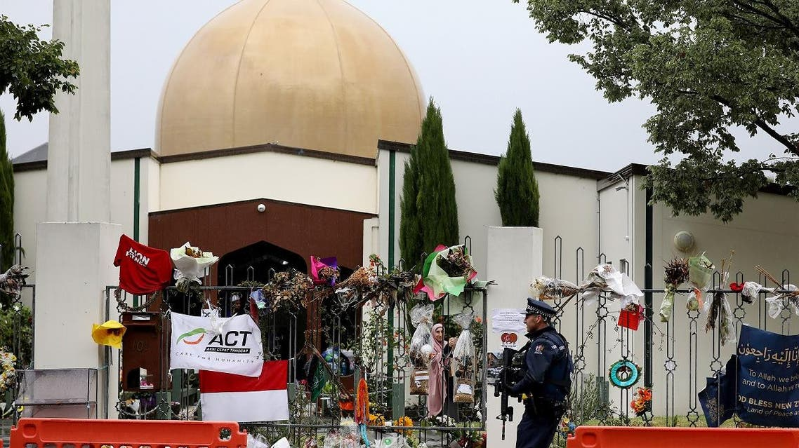 An armed police officer (R) stands guard outside the Al Noor mosque, in Christchurch, where more than 50 people were killed. (AFP)