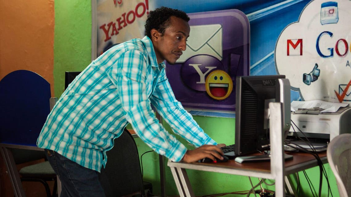 Kaleb Alemayehu, the owner of an internet cafe in the city of Adama, checks a computer on April 4, 2018. (File photo: AFP)