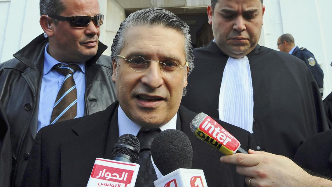Nabil Karoui leaves the Tunis courthouse after attending his trial on Jan. 23, 2012. (AP)