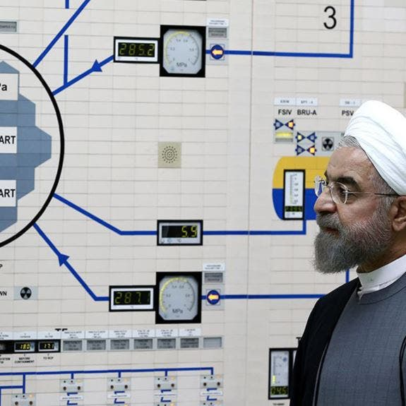 ظريف يفاوض فرنسا.. وروحاني يتشدد في طهران