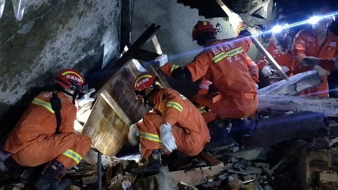 Rescuers search for earthquake survivors in the rubble of a building in Yibin early on June 18, 2019. (AFP)