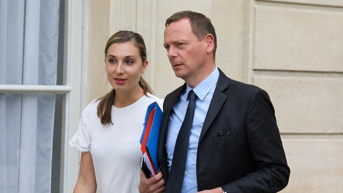 Presidential press advisor Nathalie Baudon and diplomatic advisor Emmanuel Bonne stand in the court of the Elysee Palace, on May 24, 2019, in Paris. (AFP)