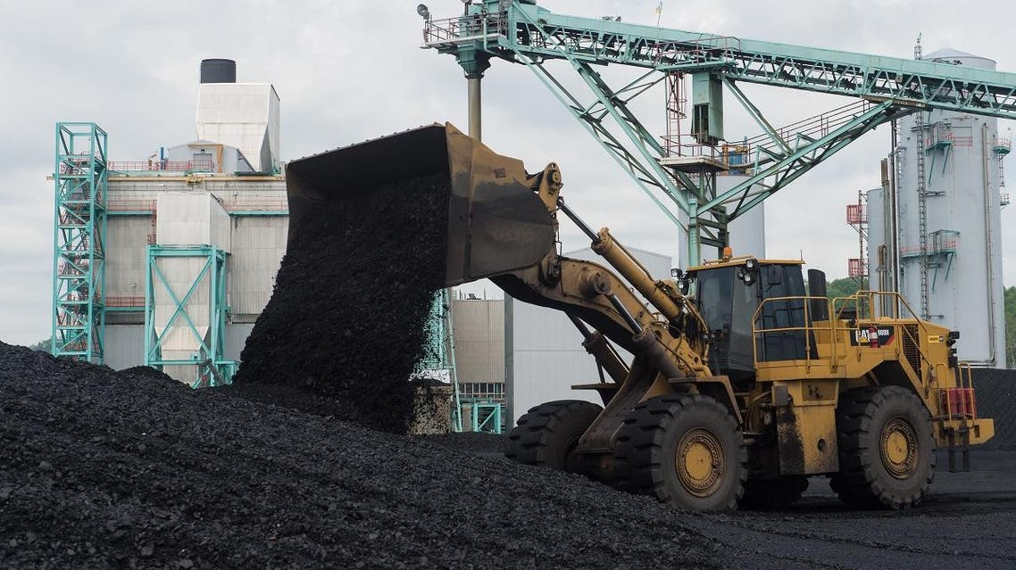 A front-end loader dumps coal at the East Kentucky Power Cooperative's John Sherman Cooper power station near Somerset, Kentucky. (AFP)
