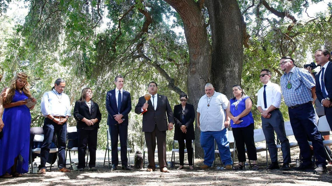 Gavin Newsom, fourth from left, at the future site of the California Indian Heritage Center in West Sacramento, Calif., Tuesday, June 18, 2019. Newsom took the occasion to formally apologize to tribal leaders from around California for the violence, mistreatment and neglect inflicted on Native Americans throughout the state's history. (AP)