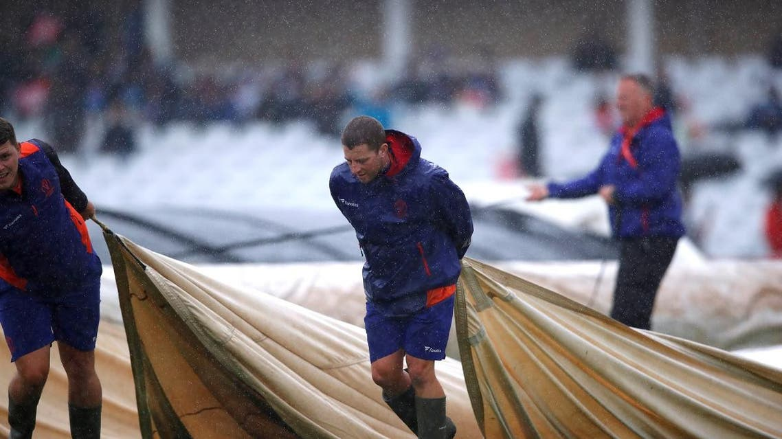 Ground staff put covers on the pitch as rain delays play at Trent Bridge, Nottingham, during the  ICC Cricket World Cup match between India and New Zealand on June 13, 2019. (Reuters)