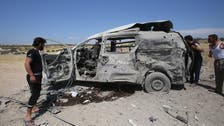 Two rescuers among 14 civilians killed by Syria regime fire