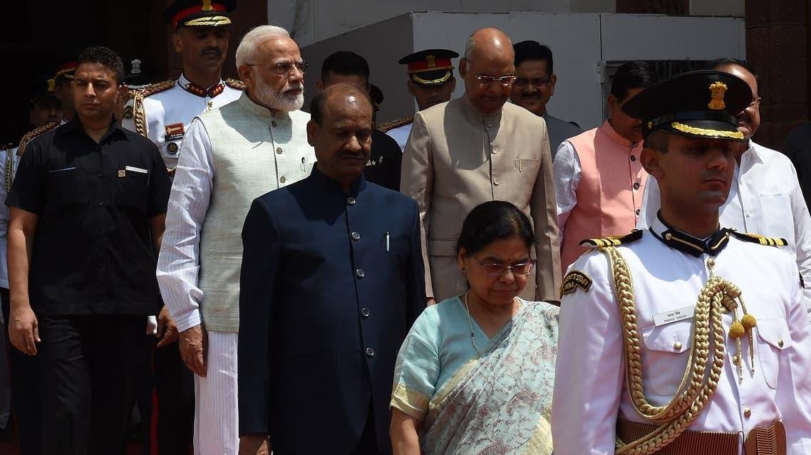 Indian President Ram Nath Kovind (2R, behind), Indian PM Modi (2L behind) and Parliament speaker Om Birla (C) arrive at Parliament in New Delhi on June 20, 2019. (AFP)
