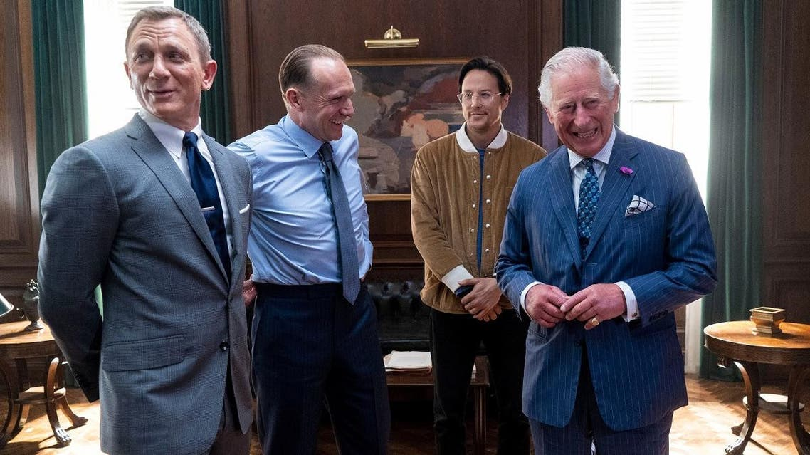 Prince Charles poses with Daniel Craig, Ralph Fiennes and US Director Cary Joji Fukunaga as he tours the set of the 25th James Bond Film at Pinewood Studios in Iver Heath, Buckinghamshire, Britain June 20, 2019. (Reuters)