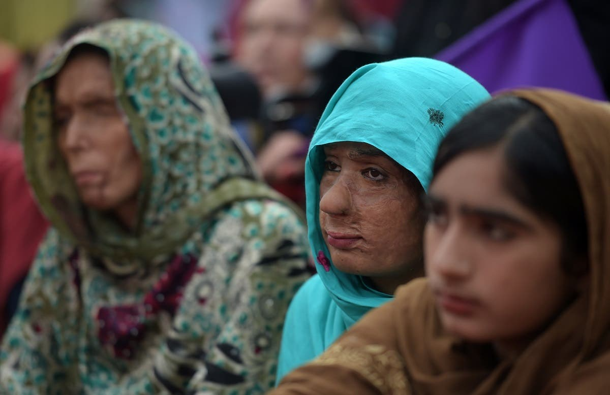 Pakistani acid victims take along with civil society activists during a march for women rights on International Women's Day in Islamabad on March 8, 2019. (AFP)