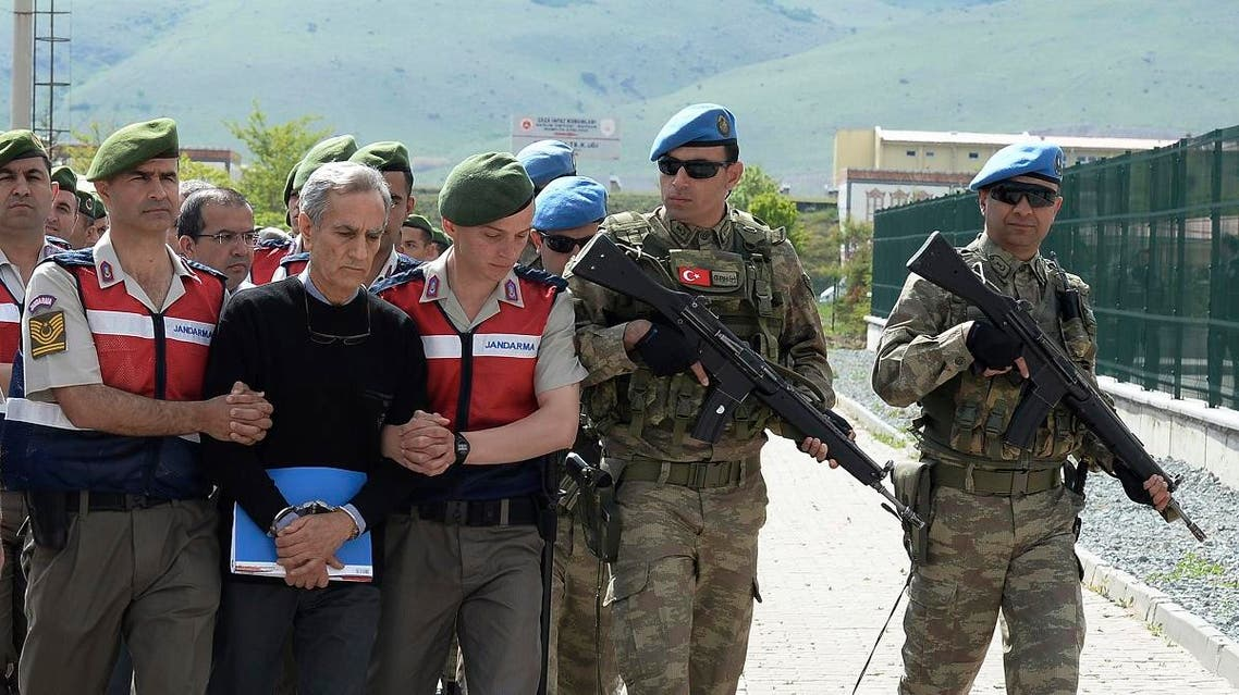 Turkish former Air Forces commander Gen. Akin Ozturk, front, escorted to a courthouse in Ankara. (File photo: AP)