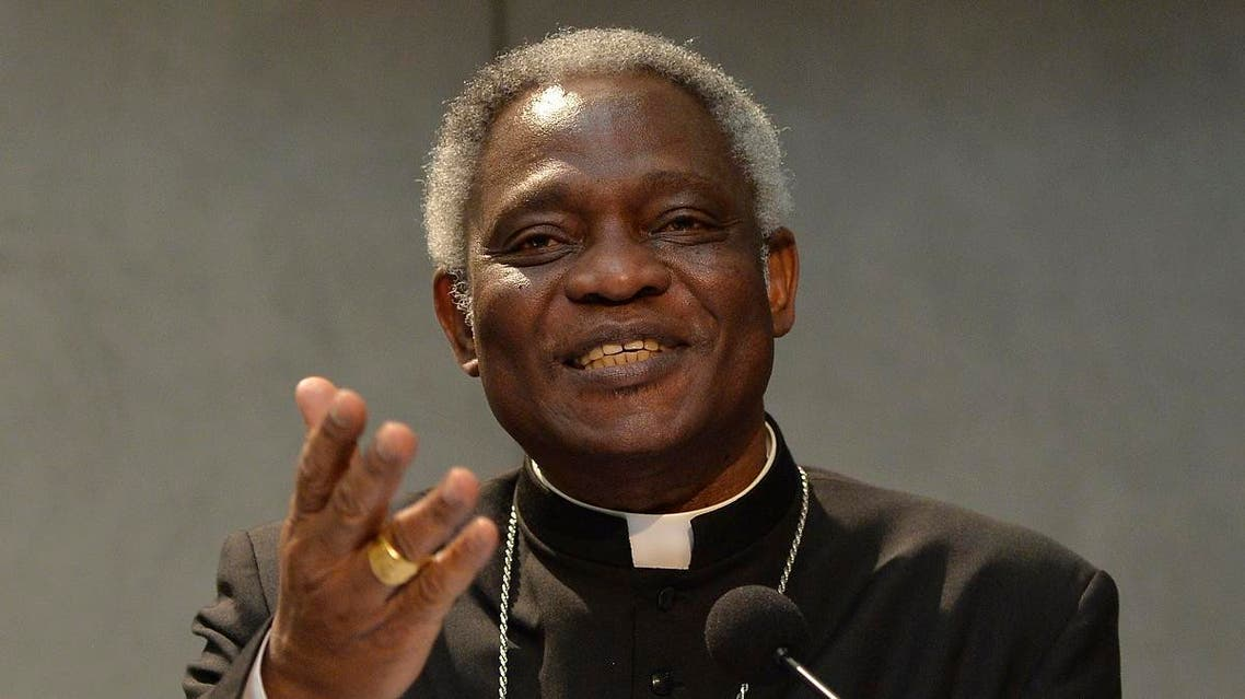 """Ghanaian cardinal Peter Kodwo Appiah Turkson attends the signature of the """"Global Freedom Network"""" agreement between representatives of Catholic church, the Anglican church and Sunni University Al-Azhar to fight against """"modern forms of slavery and human trafficking,"""" on March 17, 2014 at the Vatican. (AFP)"""