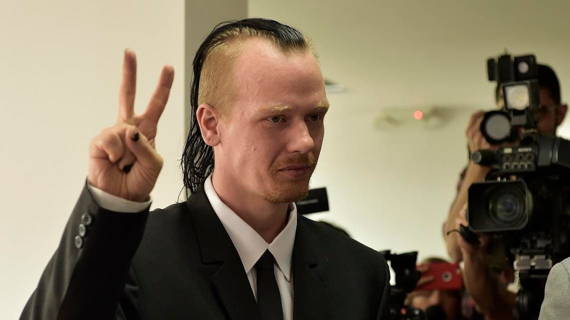 Ola Bini, a Swedish national accused of an alleged cyber-attack and who is close to WikiLeaks founder Julian Assange, gestures before the appeal hearing to his order of preventive detention, at the Provincial Court of Pichincha in Quito, on May 2, 2019.