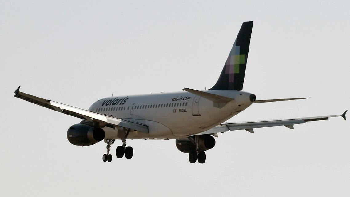 A plane of Mexico's Volaris airlines approaches Benito Juarez International Airport in Mexico City on January 17, 2018. (AFP)