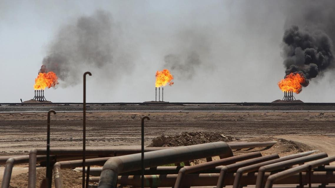 Flames emerge from the flare stacks at the West Qurna-1 oilfield, which is operated by ExxonMobil, near Basra, Iraq June 1, 2019. (Reuters)